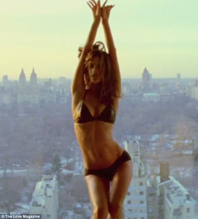 Sky-scraping: In it, the 32-year-old supermodel seduced the camera in a solo sequence where she writhed on a bed and grinded against a sun-drenched window