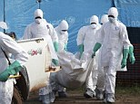Liberian health workers wearing protective clothing carry the body of a woman who died of the Ebola virus away from an isolation unit in Foya, Lofa County for burial