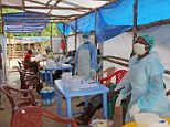 Medical workers in Sierra Leone wear protective clothing while treating patients infected with the Ebola virus in Kenema District
