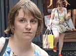 Lena Dunham displays her alabaster legs in a colourful printed mini dress while shopping in New York