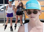 It's wheel fun! Reese Witherspoon rollerblades with daughter as she shows off her toned pins in purple shorts
