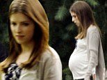 Bumping along: Anna Kendrick displayed a giant baby bump while pictured for the first time on the set of The Hollars in Los Angeles on Friday