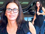 Taking the plunge! Make-up free Courteney Cox flashes cleavage in low-cut top as she arrives to meeting in Beverly Hills