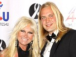 Drama: Linda Hogan's ex boy toy, Charlie Hill, is suing her for $1.5 million for menial labour he performed during their relationship - pictured together in LA in November 2010