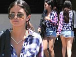 Selena Gomez exposes her derriere in VERY short cut-offs while heading to a meeting... after she 'denies Bieber-Bloom love triangle'