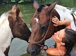 Earth Mother Gisele Bundchen proves her touch extends to four-legged creatures as she bathes in the water with a horse and her foal during Costa Rican vacation