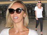 Jet-set style! Giuliana Rancic is casual chic in white T-shirt and pumps as she arrives at LAX