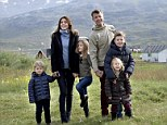 Danish Crown Prince Frederik (3-R) and Crown Princess Mary (2-L) pose for photographs with their children Prince Christian (R), Princess Isabella (3-L), Prince Vincent (L) and Princess Josephine (2-R) as they start their official visit in Igaliko, Greenland.