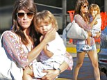 Selma Blair puts her toned legs on parade in denim cut-offs during trip to the market with son Arthur
