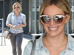 Her hard work is paying off! Hilary Duff highlights shapely legs in skintight jeans as she leaves the gym