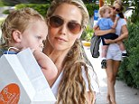 Elizabeth Berkley shows off her toned legs in denim shorts as she enjoys day out with son Sky