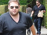 21 plump street! Jonah Hill shows off his new fuller figure as he takes his dog for a walk in Los Angeles