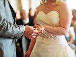 DAKETT Bride and groom exchange wedding rings during the wedding ceremony.