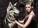 Animal instinct: Dutch supermodel Lara Stone poses with two wolves in a  fashion shoot for Vogue, which was styled by Kate Moss