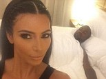 Sleepy Kanye! West is all partied out as Kim Kardashian posts a bedroom selfie of the rapper tired in bed after Ibiza bash on Friday