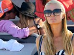 Blossoming romance: Paris Hilton has been keeping the company of a new mystery love interest while on vacation in Ibiza - pictured together on Saturday
