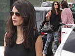Arriving in style! Amal Alamuddin looks chic in camouflage-print skinnies after catching flight to Milan with her mother Baria