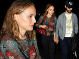 Natalie Portman and her husband Benjamin Millepied walk hand in hand as they arrive at Beyonce and Jay Z's concert in LA