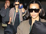 Kim Kardashian and Kanye West arrive back at LAX after partying it up at star-studded bash in Ibiza