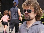 She's daddy's princess! Peter Dinklage enjoys a leisurely stroll with his adorable two-year-old daughter Zelig in Toronto