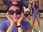 Emmy Rossum sports mouse ears and dons floral shorts as she larks around with pals at Disneyland