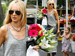 Kimberly Stewart was seen making her way, looking ever so stylish, through the various stands holding the hand of the cutest patron there. Delilah, whose father is actor Benecio del Toro, pointed out all the interesting items for sale while her mom carried the collection of white lilies and pink sunflowers.