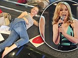 Catching up on some sleep? Bleary eyed Kylie Minogue takes a breather as she rehearses for upcoming Kiss Me Once tour