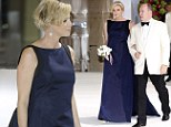 Pregnant Princess Charlene of Monaco dresses baby bump in glamorous midnight blue gown as she steps out with husband Prince Albert at charity ball