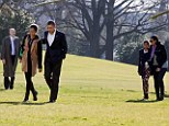 Protection: The first family of Barack and Michelle Obama, Sasha and Malia walk across the lawn of the White House guarded by Secret Service agents