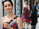 Summer to street chic: Krysten Ritter started her Saturday in a floral frock, left, before donning a black dress, right, in New York City