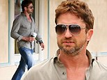 Gerard Butler keeps a casual stride as he and a friend check out the latest surf gear in Malibu, Callifornia