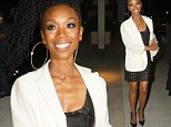 A smiling Brandy shows off her toned legs in a black lace mini skirt and crisp white blazer while out in LA
