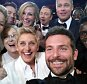 """Actor Jared Leto, Jennifer Lawrence, Meryl Streep, Ellen DeGeneres, Bradley Cooper, Peter Nyongío Jr., and (second row, from L) Channing Tatum, Julia Roberts, Kevin Spacey, Brad Pitt, Lupita Nyong'o and Angelina Jolie pose for a """"selfie"""" portrait on a cell phone during the Oscars at the Dolby Theatre in Los Angeles, USA on Sunday, March 2, 2014.   This image released by Ellen DeGeneres shows  (AP Photo/Ellen DeGeneres)"""