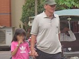 Arrest: Suspected paedophile Michael Jones was arrested by Cambodian police after he was snapped strolling hand in hand with an 11-year-old girl in Phnom Pen
