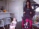 She's learned from the best! Hilaria Baldwin watches as her adorable baby daughter Carmen strikes a standing yoga pose