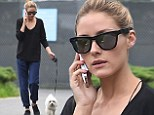 Style maven Olivia Palermo is unrecognisable in baggy sweater and tracksuit pants as she takes her pooch for a stroll