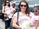 Doting mom: Kristin Davis carried her adopted daughter Gemma in her arms in Los Angeles on Saturday