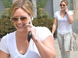 Hilary Duff smiles and chats as she walks to a spa in West Hollywood