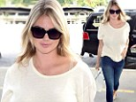Can she do no wrong? Kate Upton turns on the sex appeal in skinny jeans and white top while catching a flight at LAX