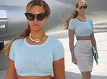 Top of the crops! Beyonce bares her toned midriff in tiny pastel T-shirt as she poses in front of a private jet