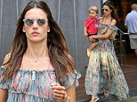 Casual: The model was seen wearing flip flops with her maxi dress