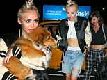 Miley Cyrus carries her new dog Emu after a concert in Philadelphia
