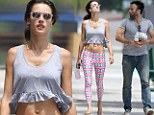 Alessandra Ambrosio shows off her taut tummy and slender legs in crop top and printed tights after a workout with fiancé Jamie Mazur