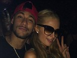 All smiles: Neymar (left) posted an Instagram picture of him partying with Paris Hilton (right) in Ibiza