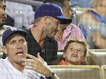 Like father, like son: David shared a laugh with nine-year-old son Cruz