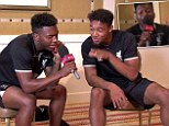 Admiring: Ibe looks up at Sturridge as the Liverpool forward raps during the Hip-Hop challenge