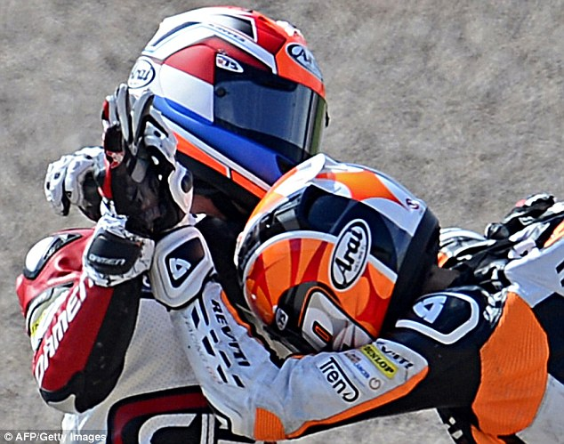 Close combat: The riders helmets and protective leathers meant they couldn't do each other much harm