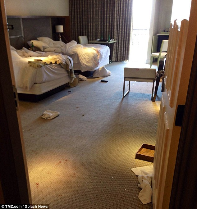 What a mess: As well as blood trails on the carpet, broken glass was also scattered all over the floor