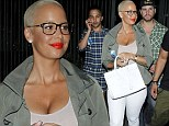Amber Rose shows off her d�colletage in low-cut pink tank top as she exits the Beyonc� and Jay Z concert without husband Wiz Khalifa