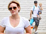 Need a hand? Hilary Duff looks casual as she shops with son Luca and estranged husband Mike Comrie who struggles with numerous bags